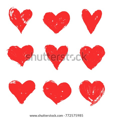 Set of red grunge hearts. Vector heart shapes.