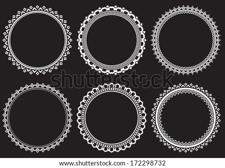 set of round frames on a black...