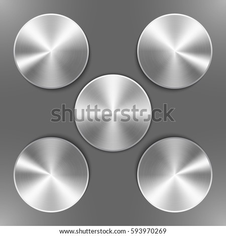 Set of round silver disks with brushed metal textures and different angles of reflection isolated on gray background