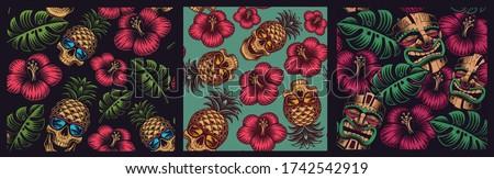 Set of seamless coloured patterns in Hawaiian style with skull pineapple, tiki mask. Stockfoto ©