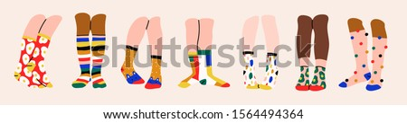 Set of seven pairs of female or male legs in the socks. Cool various prints. Stylish underwear. Fashion accessories. Footwear. Hand drawn vector colored trendy illustration. Flat design