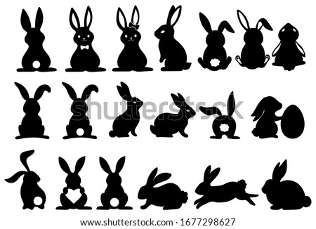 Set of silhouettes of rabbits. Collection of rabbits in various poses. Easter bunny. Vector illustration on a white background.