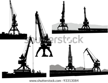 Set of silhouettes of the port cranes on a white background