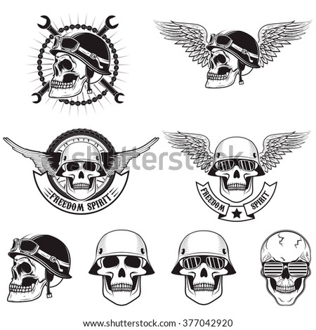 set of skulls in biker helmets