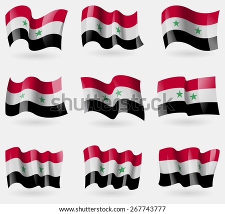 set of syria flags in the air