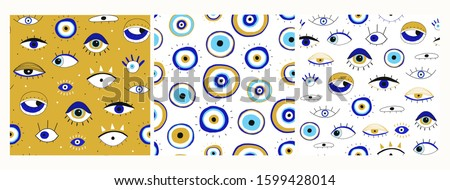 Set of three seamless patterns. Evil eyes. Hand drawn various talismans. Different shapes. Flat design. Free hand drawing style. Contemporary modern trendy vector illustrations. ストックフォト ©