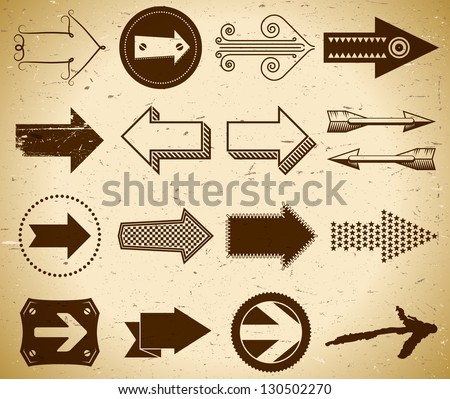 Set of trendy vintage arrows on grungy paper.