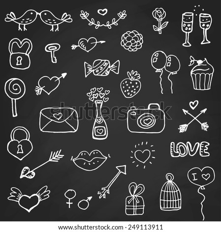 Set of valentine`s day doodle elements on chalk board
