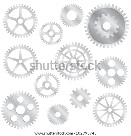 Set of various steel gear wheels on the white background.