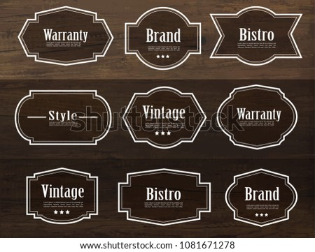 Set of vector vintage style frame labels and elements for design, carve banner on wood texture.