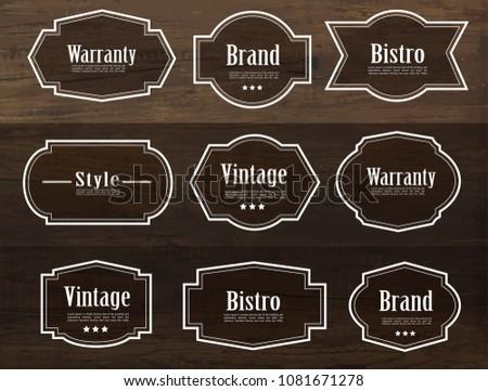 Set of vector vintage style frame labels and elements for design, carve banner on wood texture.