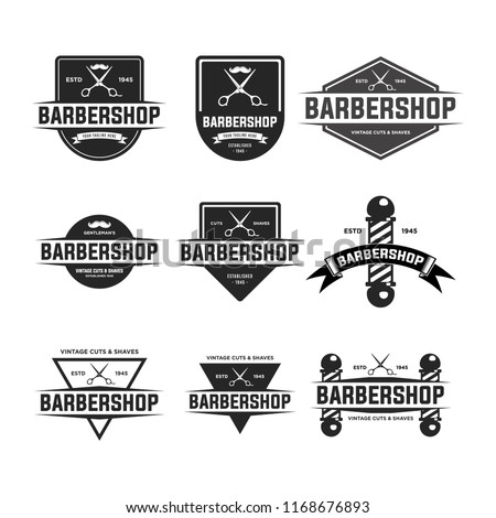 Set of vintage barber shop badges and emblems . EPS 10