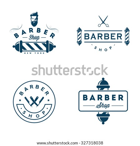 Set of vintage barber shop badges and emblems isolated on white background