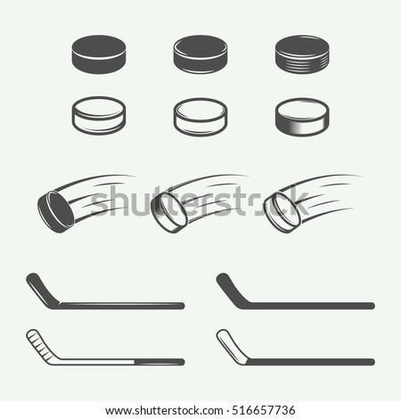 Set of vintage hockey elements in retro style. Puck, hockey stick, flying puck. Graphic Art. Vector Illustration.