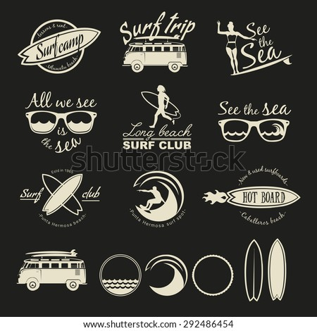 Set of vintage surfing logos labels badges and design elements