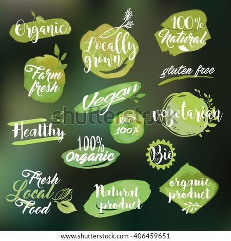 Set of watercolor hand drawn labels and badges for organic food and drink, natural products, restaurant, healthy food market and production, on the nature blurred background. Vector illustrations.