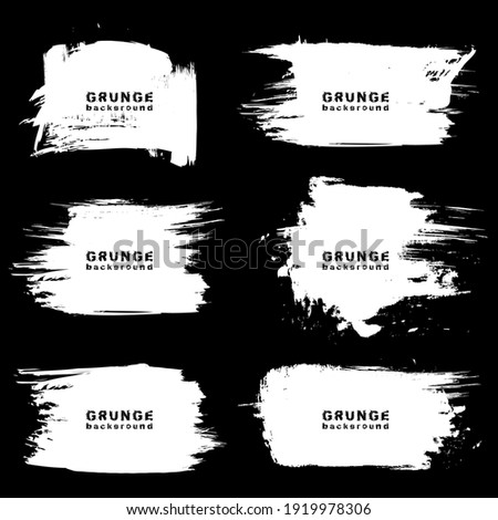 Set of white grunge urban backgrounds. Vector illustration. Isolated. Distress texture. Ink brush strokes. Dirty artistic design element for text frames, banners, posters and abstract background