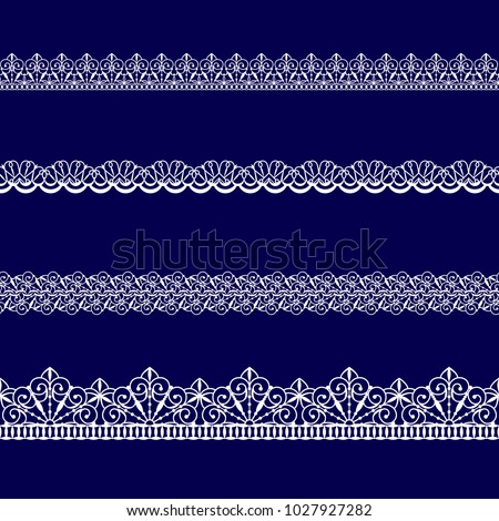 set of white lace ribbons on a blue background #1027927282