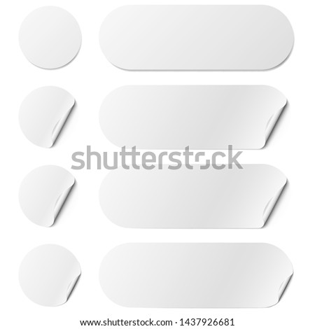 Set of white round and oval adhesive stickers with a folded edges, isolated on white background. #1437926681