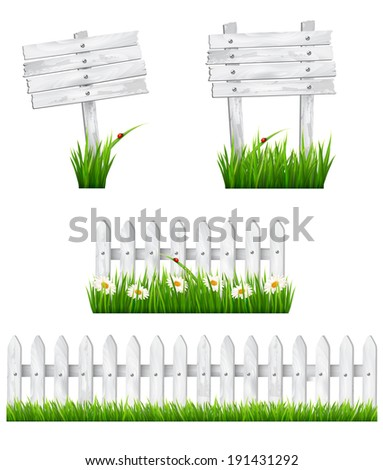 set of white wooden signs and a