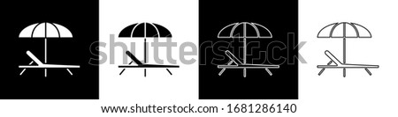 Set Sunbed icon isolated on black and white background. Beach umbrella and Sun lounger.  Vector Illustration