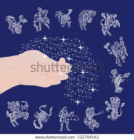 set with signs of zodiac on starry sky and hands with stars