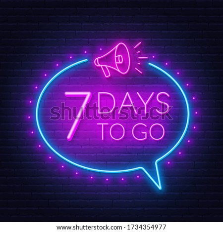 Seven days to go neon sign on brick wall background. Stock foto ©