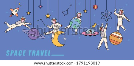 Several planets are adorned like mobiles, and astronauts are playing happily in them. flat design style minimal vector illustration.