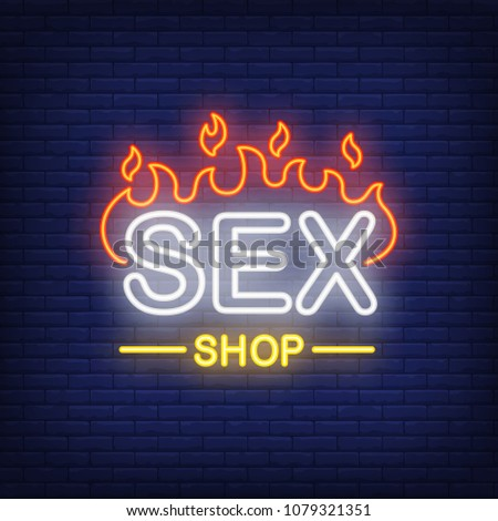 Sex shop lettering on fire. Neon sign on brick background. Store, electric sign, nightclub. Erotica concept. For topics like entertainment, love, business
