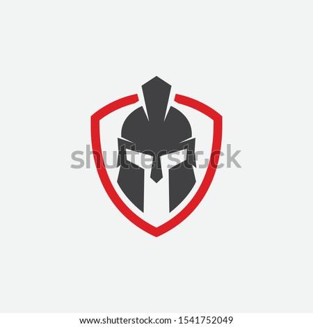 shield and helmet of the Spartan warrior symbol, emblem. Spartan helmet logo, vector illustration of spartan shield and helm, Spartan Greek gladiator helmet armor flat vector icon