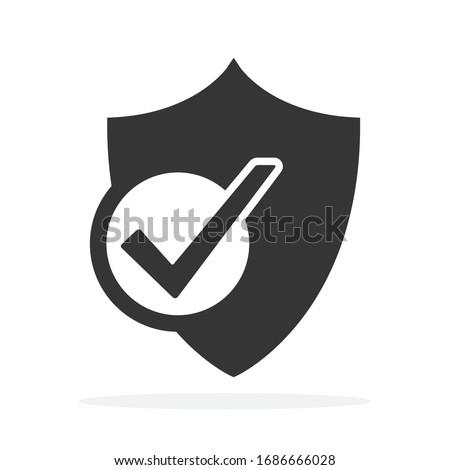Shield icon with check mark symbol. Vector Shield icon. Black security icon. Concept of security