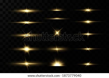 Shining golden stars isolated on black background. Effects, glare, lines, glitter, explosion, golden light. Vector illustration Сток-фото ©