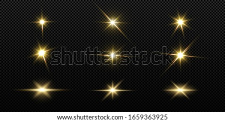 Shining golden stars isolated on black background.  Shining stars, beautiful golden rays. Vector illustration.