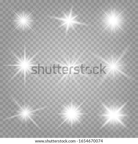 Shining stars isolated on a transparent white background. Effects, glare, radiance, explosion, white light, set. The shining of stars, beautiful sun glare. Vector illustration.  Сток-фото ©
