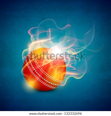 Shiny cricket ball in flame on blue background.