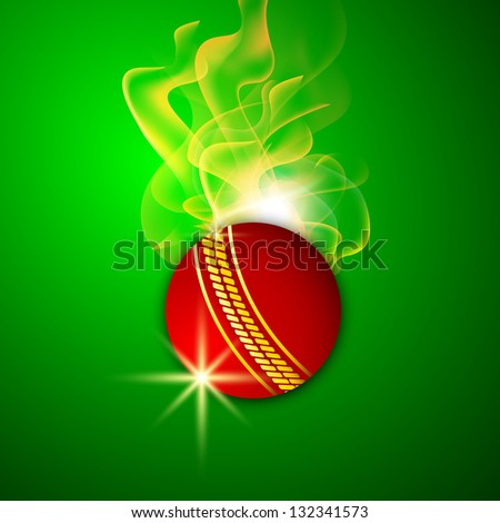 Shiny red cricket ball in flame on green background.
