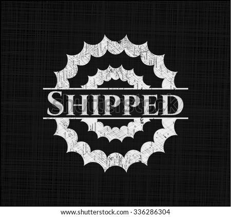 Shipped chalk emblem written on a blackboard