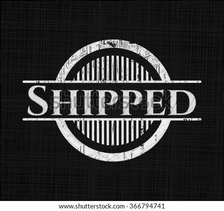 Shipped chalkboard emblem on black board