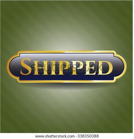 Shipped gold emblem or badge