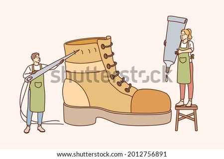 Shoemaker and designing footwear concept. Male and female characters standing mending shoe for handmade shoes, retro manufacturing for customers vector illustration Stock foto ©