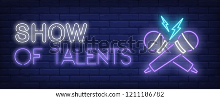 Show of talents neon text with crossed microphones. Show invitation advertisement design. Night bright neon sign, colorful billboard, light banner. Vector illustration in neon style.