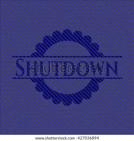 Shutdown emblem with jean background