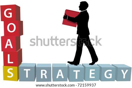 Silhouette businessman builds his business strategy adding blocks to achieve goals