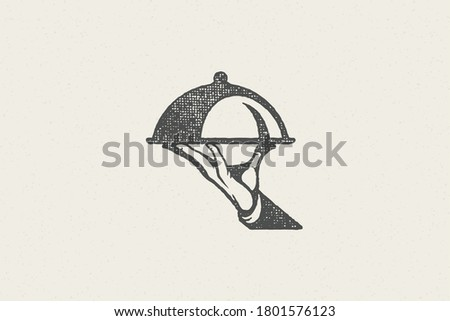 Silhouette hand of waiter carrying dish with cloche hand drawn stamp effect vector illustration. Vintage grunge texture emblem for package and menu design or label decoration.
