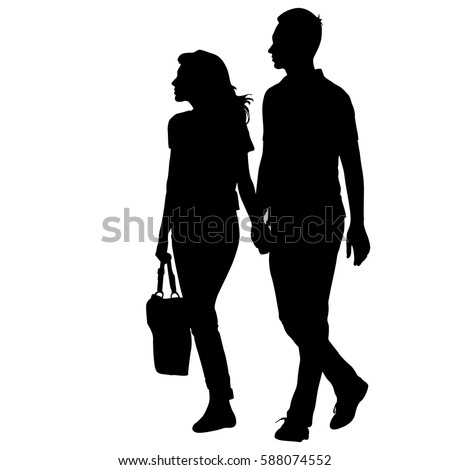 Silhouette man and woman walking hand in hand.