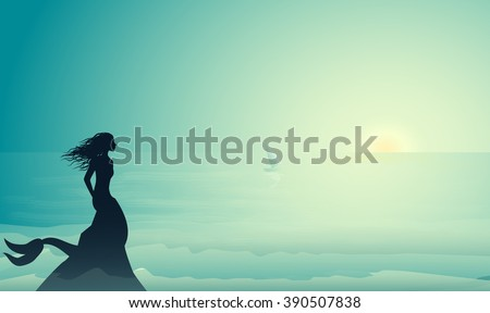 silhouette mermaid sitting on