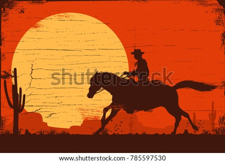 silhouette of a cowboy riding a