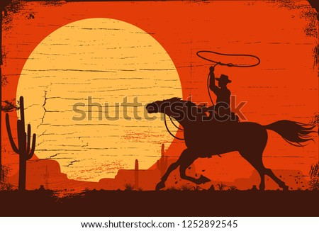 silhouette of a cowboy riding