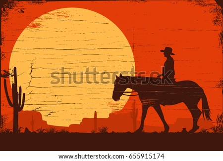 Silhouette of a cowboy riding horse on a wooden board