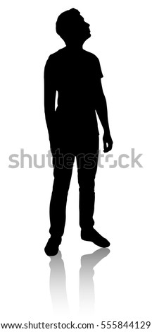 Silhouette of a man who looks up. A man looks into the distance.